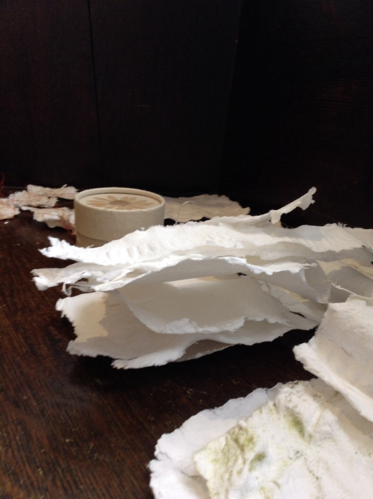 Some small pieces of handmade cotton rag paper after drying